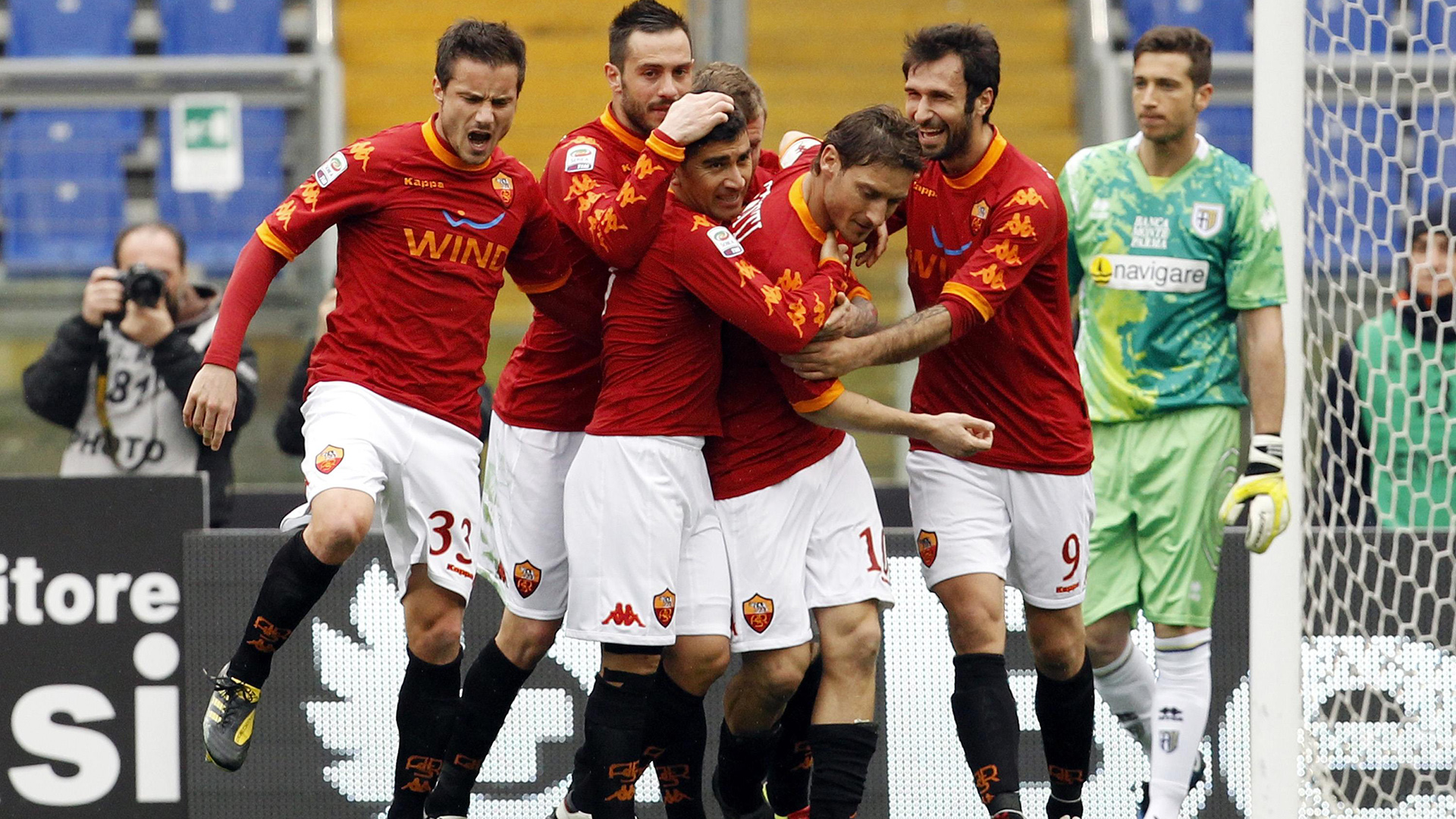 AS Roma's captain Francesco Totti (3rd R) celebrates with his teammates after scoring against Parma during their Italian Serie A soccer match at the Olympic stadium in Rome February 27, 2011. REUTERS/Giampiero Sposito (ITALY - Tags: SPORT SOCCER)